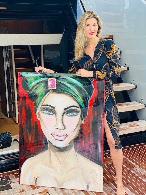about me Corinn Pruis ArtbyCoco with one of my paintings